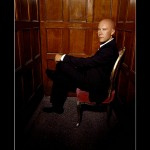 Lex Luthor On Chair Portrait Wallpaper