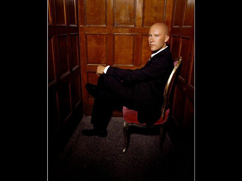 Lex Luthor On Chair Portrait Wallpaper 800x600